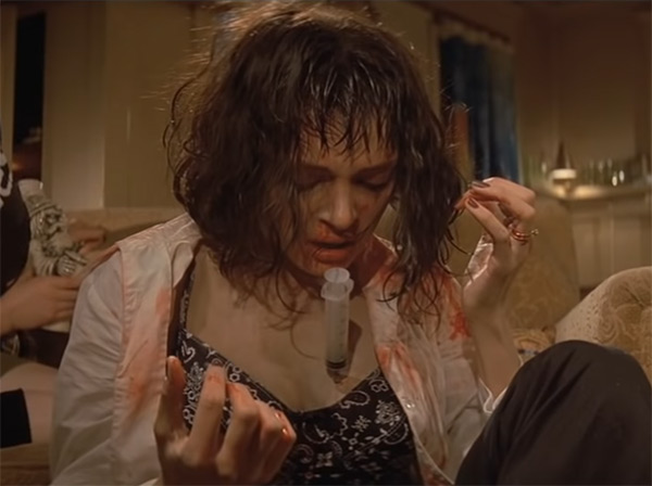 Uma Thurman with a syringe in her chest