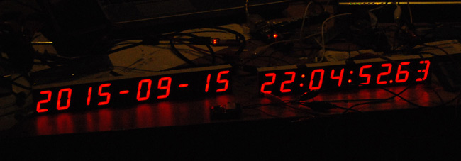 Two halves of the clock wired up and showing the date and time