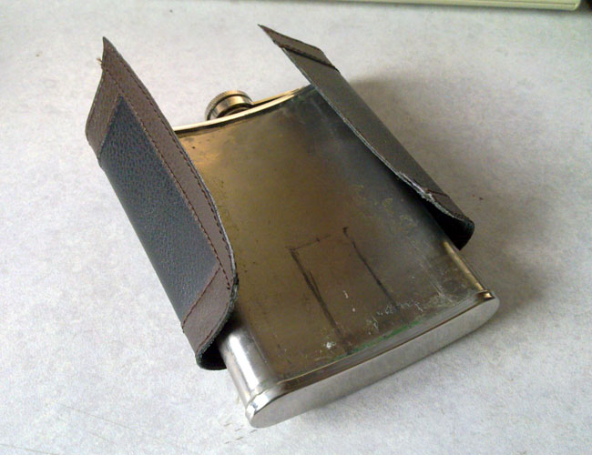 Hip flask with cover removed and cutout marked