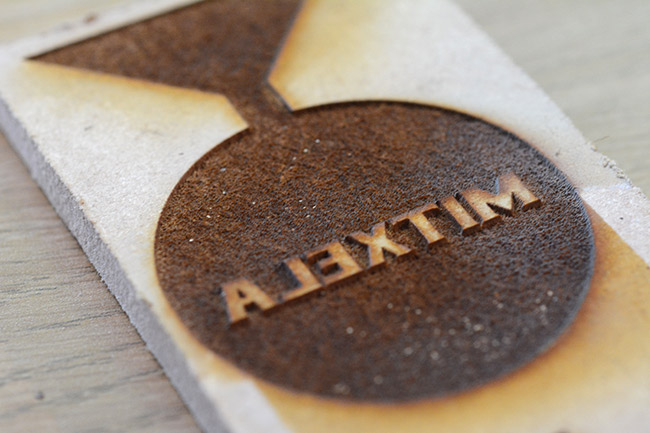 Laser etched mitxela logo in the MDF, mirrored