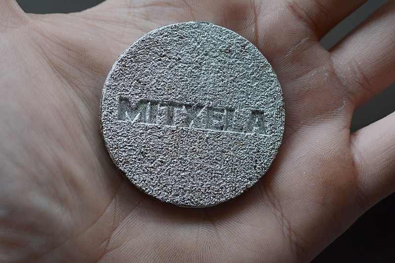 Coarse texture on the mitxela logo in the medalion