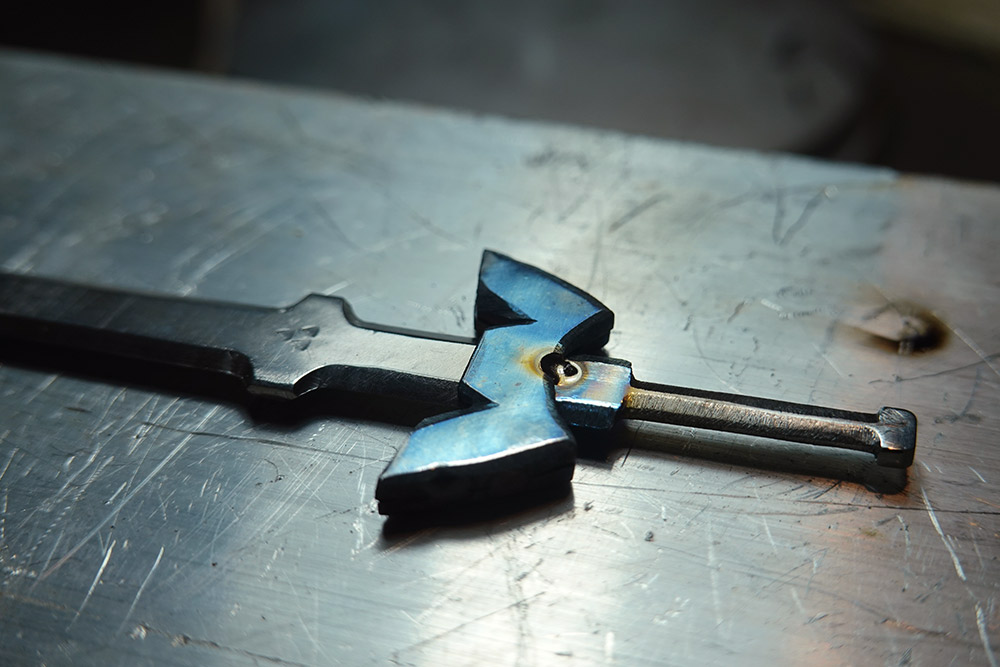 The blue guard welded to the handle