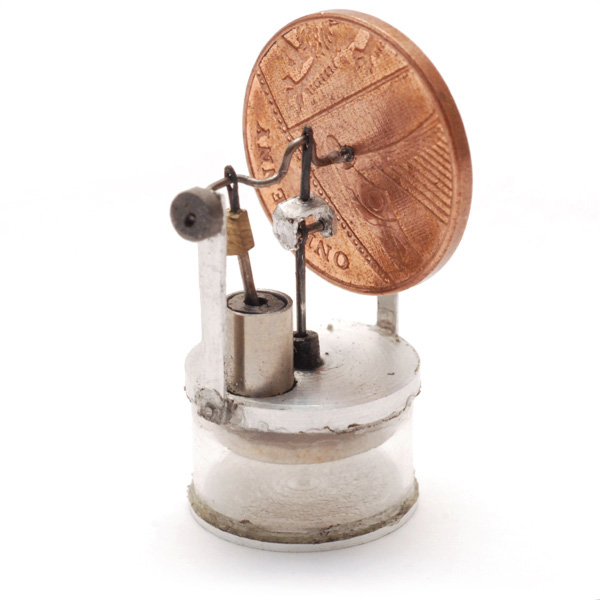 Tiny stirling engine with penny as the flywheel