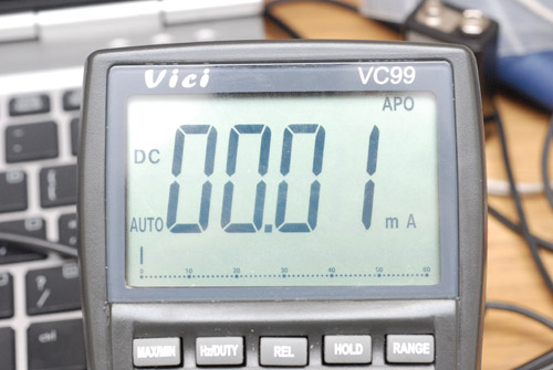 Closeup of a multimeter screen with 0.01mA showing