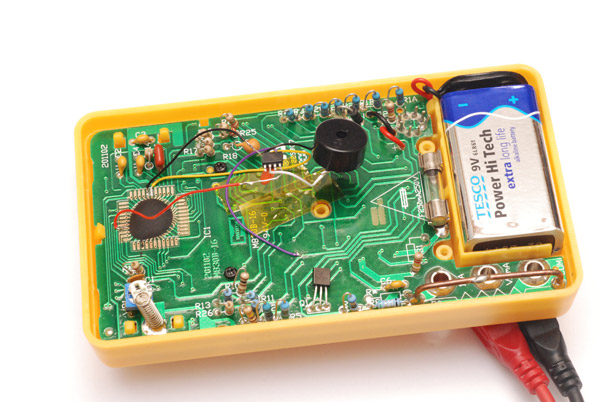 The modification floating inside the enclosure of the multimeter