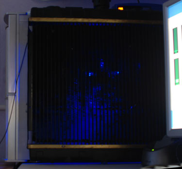 Blue light filters through the radiator on the side of the PC