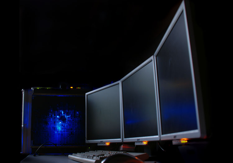 Stylish shot of the finished PC with monitors off, LEDs glowing