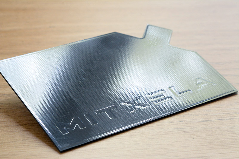 Reverse of the stylocard, with embossed mitxela logo